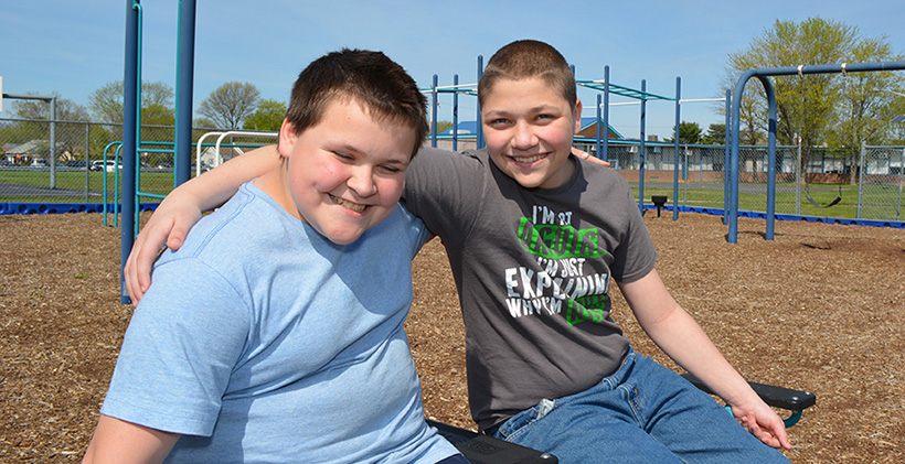 Two GPA male middle school friends on the playground