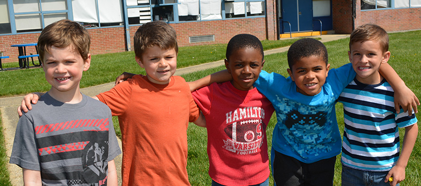 GPA Elementary student friends with arms around each others