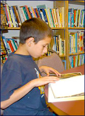 Boy studying in the library at Garfield Park Academy - A private special education school in Burlington County NJ