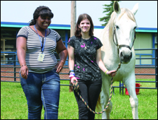 2 Garfield Park Academy students enrolled in its Equine Psychtherapy Program (EAP)