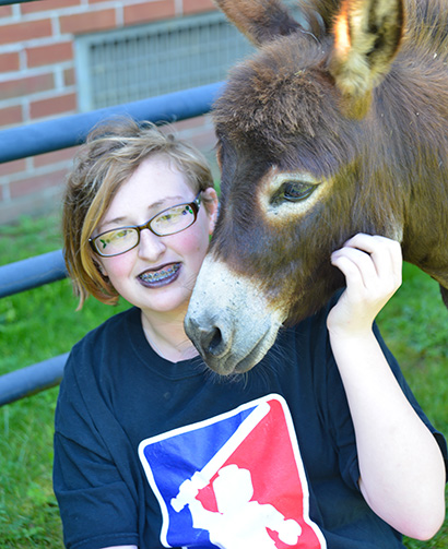 GPA femaler student with donkey in Equine Assisted Therapy Program