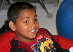 Garfield Park Academy - Spectrum Resource Center Autism Program - male hispanic student in classroom in floortime activities