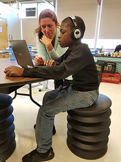 Student using ErgoErgo chair in special education classroom at Garfield Park Academy, private special education school WIllingboro NJ