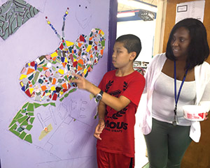 Student and teacher making mosaic mural - private special education school WIllingboro NJ