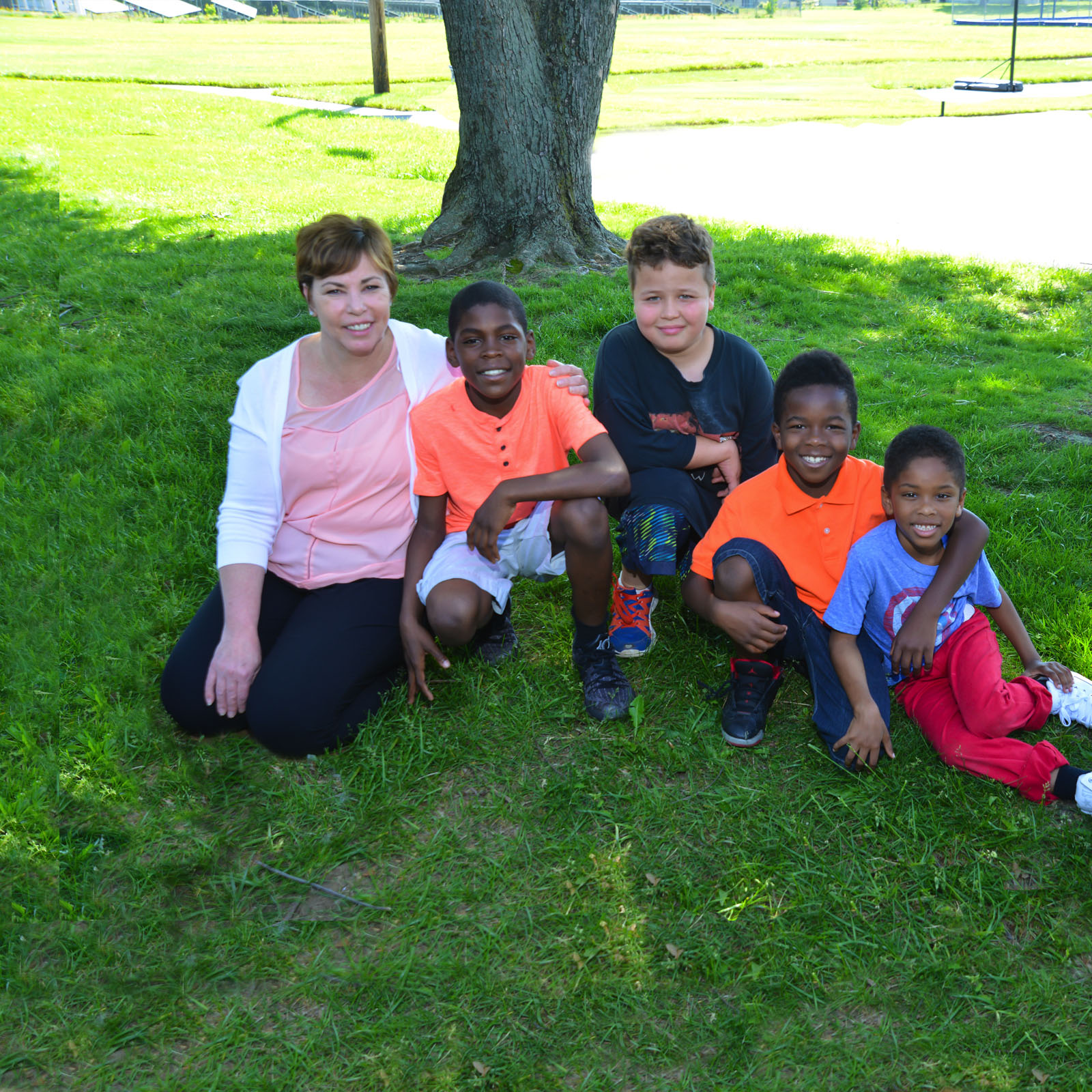 Female teacher with group of younger GPA students outdoors - private special education school WIllingboro NJ