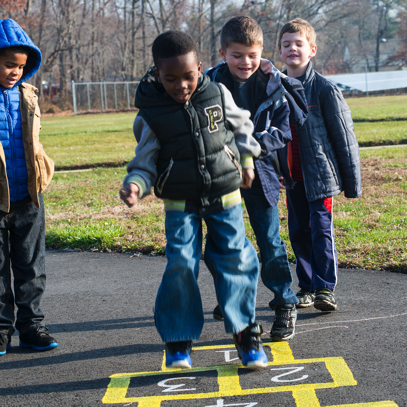 Elementary boys playing hopscotch - Willingboro NJ private special education school