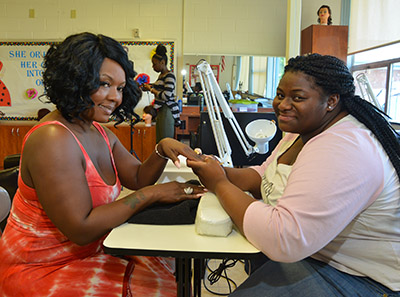 Female GPA student and teacher working on manicure lesson