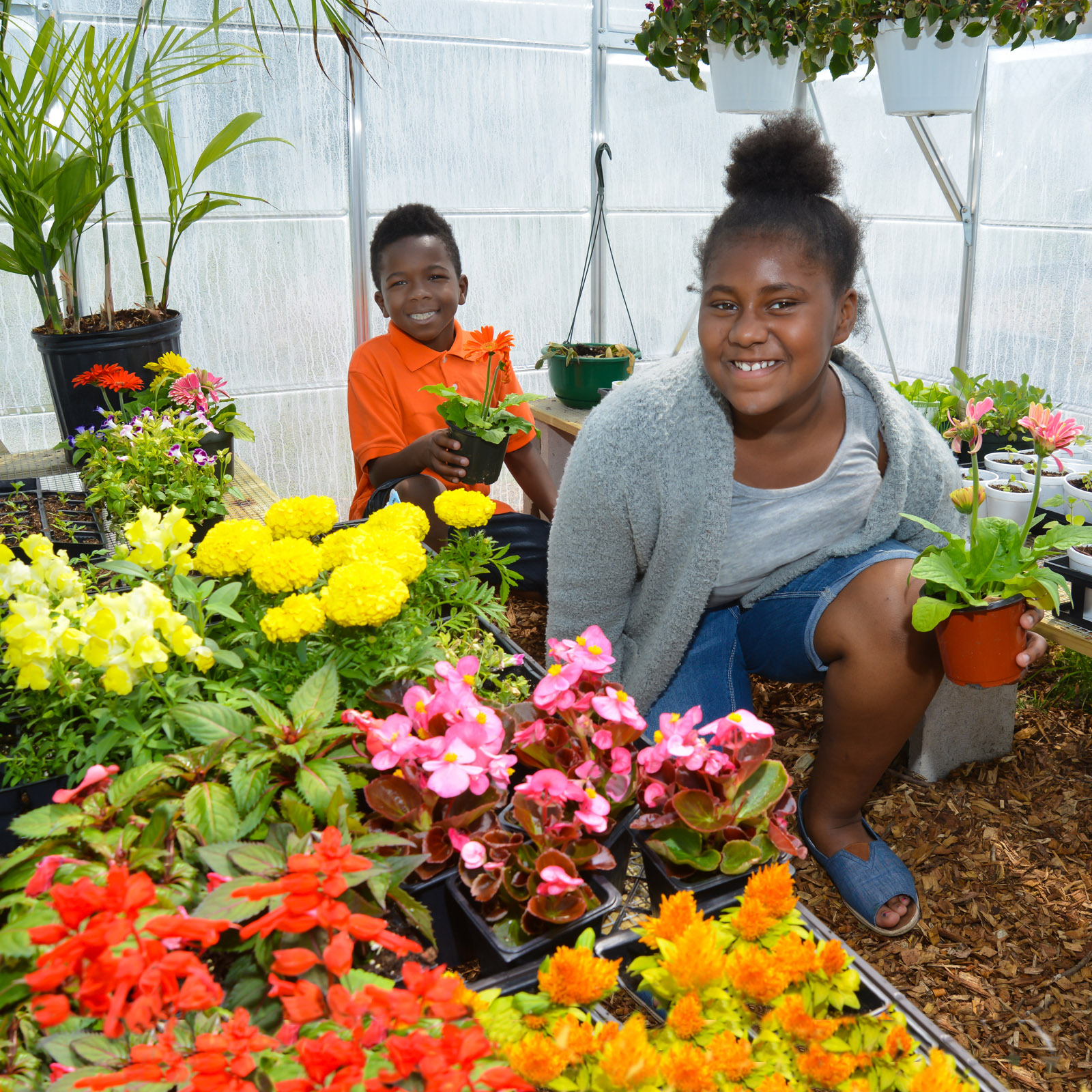 Male and female student working in greenhouse - private special education school Willingboro NJ